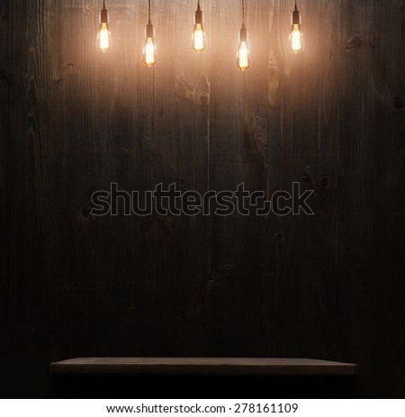 dark wooden background texture.wall with shelf and edison light bulb - stock photo