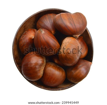 dark wooden bowl with chestnuts on white background  - stock photo