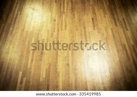 dark wooden dance floor with spot lights - stock photo