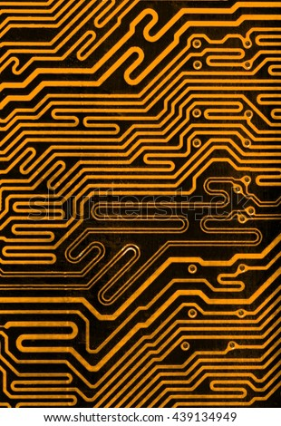 dark yellow pcb board integrated circuit motherboard computer parts abstract background - stock photo