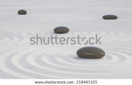 Dark Zen stones on wide sands symbol for calmness peace and relaxation - stock photo