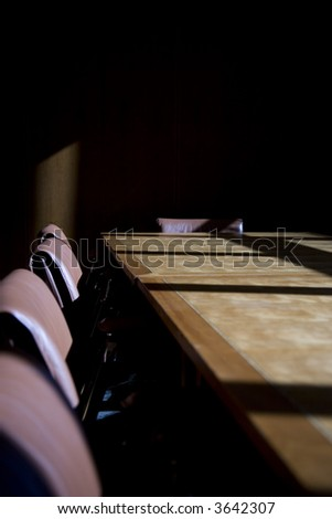 Darkened boardroom with heavy shadows, cold and uninviting - stock photo