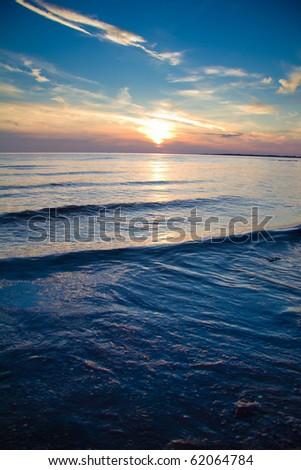 Darkening Sunset Shore - stock photo