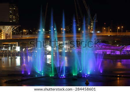 DARLING HARBOUR, AUSTRALIA - JUNE 4, 2015;  Water, fire and light show at Darling Harbour, Cockle Bay, various shows  to music run every half hour during Vivid Sydney - stock photo