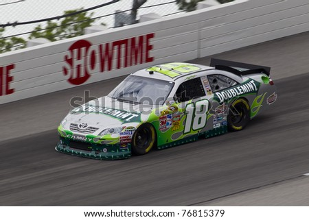 DARLINGTON, SC - MAY 06, 2011:  Kyle Busch (18) brings his race car through the turns at the Showtime Southern 500 race at the Darlington Raceway in Darlington, SC on May 07, 2011. - stock photo