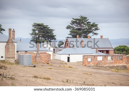 Darlington settlement with many old renovated houses on Maria Island, Tasmania, Australia, now a National Park and World Heritage Site. - stock photo