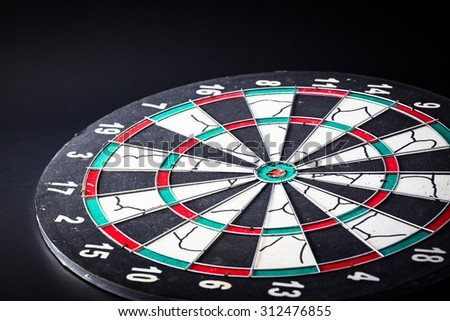 Dart board is the target and goal. Success hitting target aim goal achievement. financial concept with goal money. - stock photo