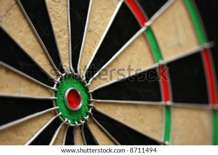 Dart Board - Shallow depth of field, focus on bullseye - stock photo