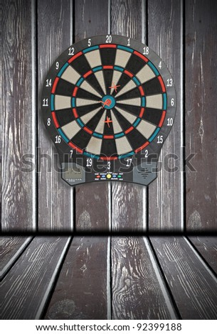 Dart Board, wood paneling in the background