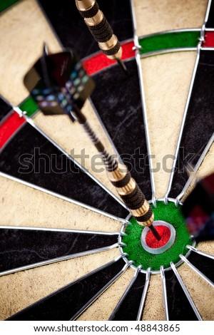 dart - bulls-eye ideal, critical hit in same center - stock photo