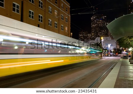 DART - Dallas public transportation streetcar at night - stock photo