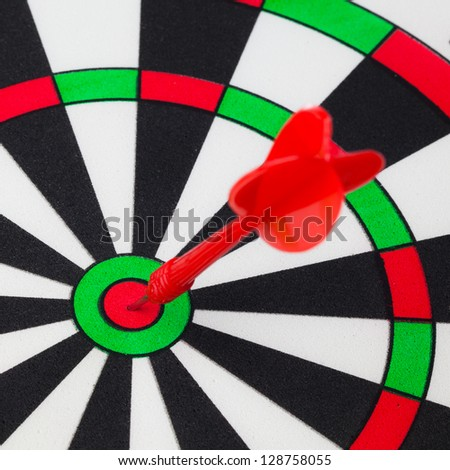 Dart hit on target in dartboard