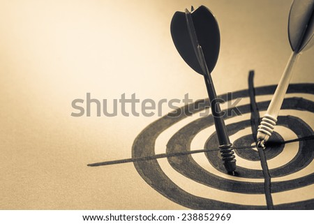 Dart hit on the center of sketching dartboard - stock photo