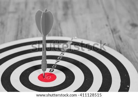Dart hit the center of dartboard - stock photo