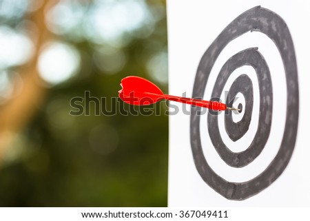 Dart hit the center of drawing target, goal setting concept - stock photo