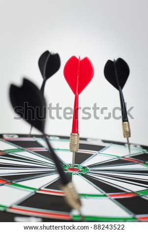 dart hit the dead centre of target - stock photo