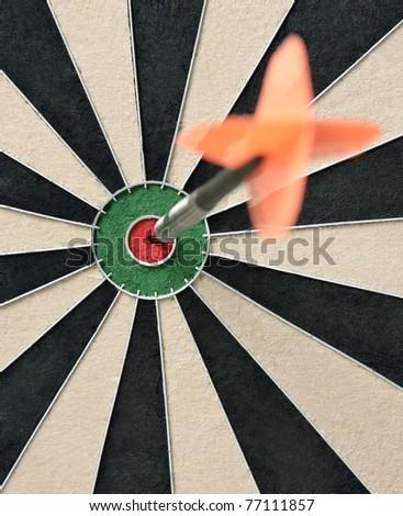 Dart in bullseye on the target - stock photo