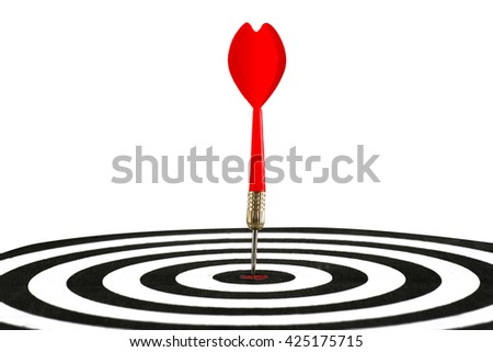 Dart in the target center of dartboard, isolated on white background - stock photo