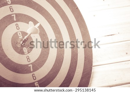 Dart is an opportunity and Dartboard is the target and goal. So both of that represent a challenge - Business concept. Bullseye and Dart. - stock photo
