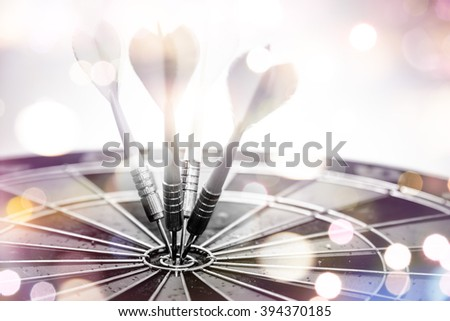 Dart is an opportunity and Dartboard is the target and goal. So both of that represent a challenge. Bulls eye and Dart. opportunity, risk management, business concept. - stock photo