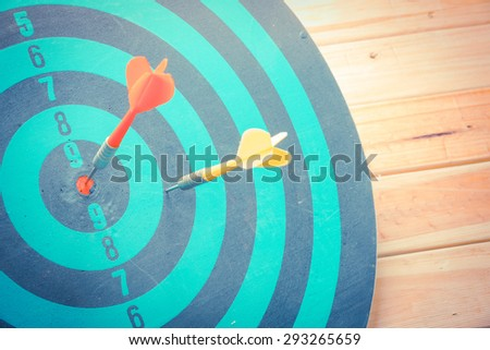 Dart is an opportunity and Dartboard is the target and goal with vintage retro picture style. success/fail business concept - stock photo