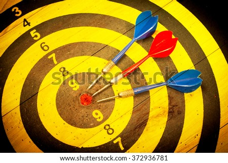 Dart is an opportunity and Dartboard is the target and goal with vintage retro picture style - stock photo
