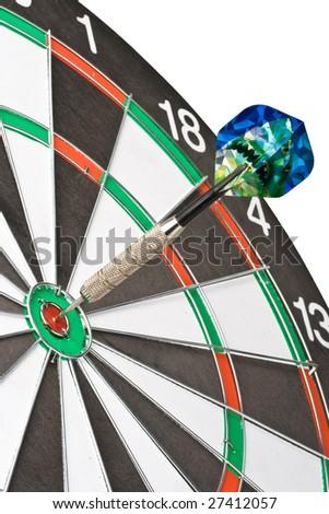 Dart on bull's eye of a dartboard. Close up. - stock photo