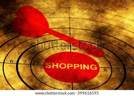 Dart on shopping target grunge concept - stock photo