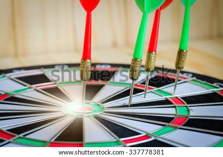 Dart stab target classic board  on wooden background