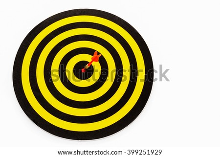 dart target with arrow in bullseye on dartboard isolated on white background with copy space, Goals target success business investment financial strategy concept, abstract background - stock photo