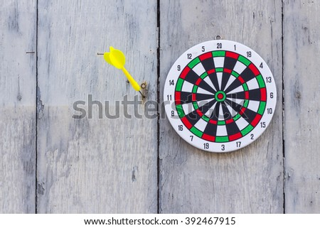 Dartboard hanging on old wooden wall. - stock photo