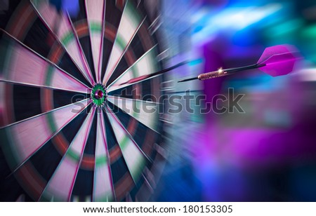dartboard on a brick wall about to get hit by dart - stock photo