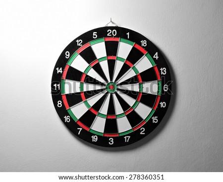 dartboard on a white wall  - stock photo