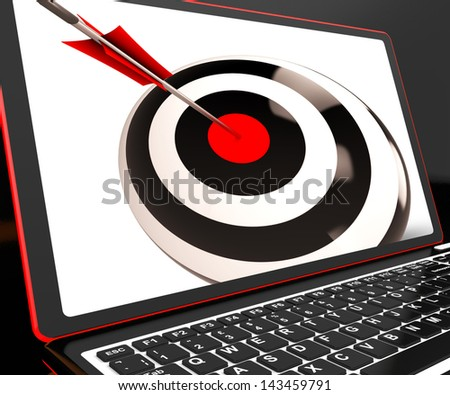 Dartboard On Laptop Shows Effectiveness And Accuracy - stock photo
