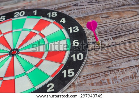 Dartboard on wood wall (miss darts) - stock photo
