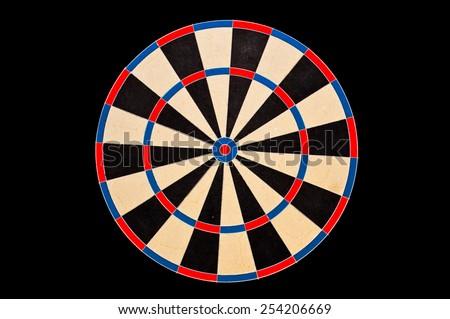 Dartboard target on black background - stock photo