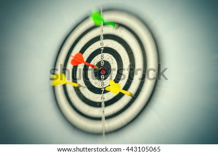 dartboard with arrow in the center - stock photo