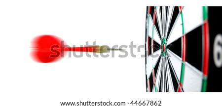 Dartboard with flight of dart on the bullseye. - stock photo