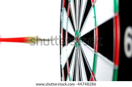 Dartboard with flight of dart on the bullseye - stock photo