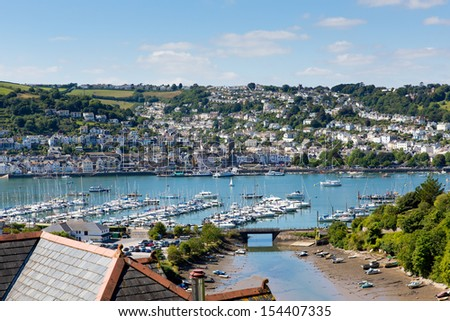 Dartmouth Devon and boats on Dart river with blue sky on summer day - stock photo