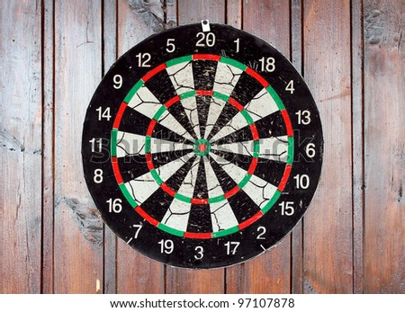 darts against a wooden wall