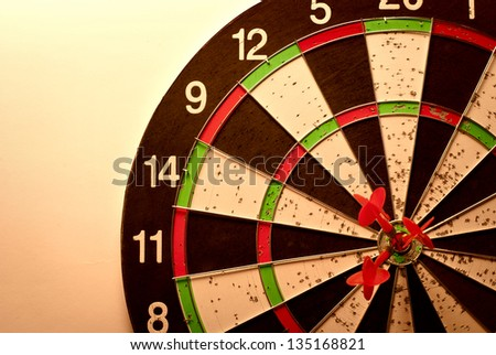 darts arrows in the target center - stock photo