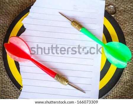 darts arrows on white paper - stock photo