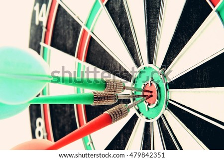Darts board close up in vintage style. Concept of accuracy and success