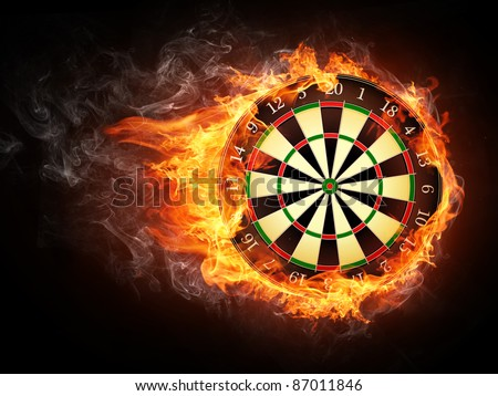 Darts Board in Fire Isolated on Black Background. - stock photo