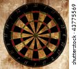 Darts board on a grunge looking background - stock vector