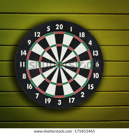 Darts board on a wooden wall background - stock photo