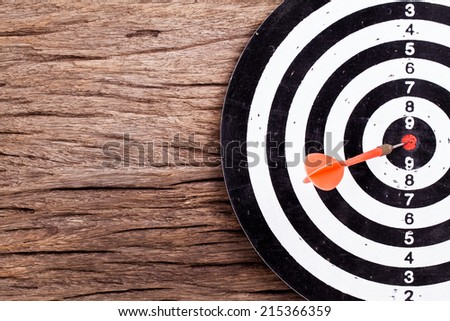Darts Board with wooden background - stock photo