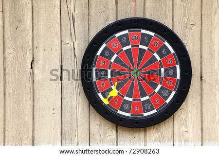darts hanging on a wall