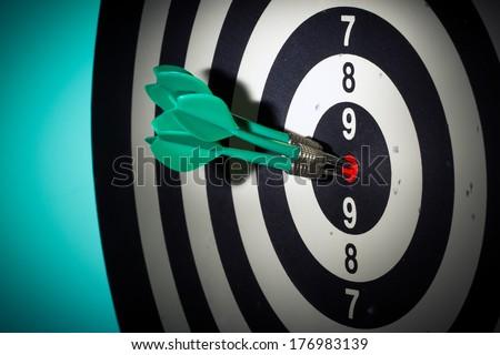 Darts hitting a target close-up - stock photo
